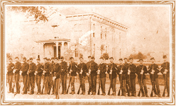 Photo of Captain Benjamin Stevens in August 1863 standing before his troops in front of the Augusta Courthouse